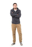 Confident young successful casual man in jumper with crossed arms Royalty Free Stock Image