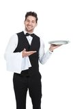 Confident young waiter with napkin and serving tray Royalty Free Stock Photos