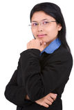 Confident young woman. A pose of a confident young business woman against very bright white screen as background that separate her naturally from it Royalty Free Stock Image