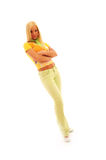 Confident Young Woman. Young confident woman with blonde hair wearing a brightly colored casual outfit on a white background stock photography