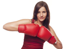 Confident young woman with boxing gloves Royalty Free Stock Photo