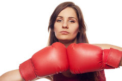 Confident young woman with boxing gloves Royalty Free Stock Photography