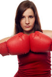 Confident young woman with boxing gloves Stock Photo