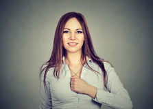 Confident young woman determined for a change. On gray background Stock Images
