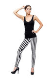 Confident young woman dressed in a leggings and shirt Royalty Free Stock Photography