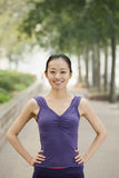 Confident Young Woman in Exercise Clothes in the Park Royalty Free Stock Photos