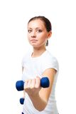 Confident young woman hold dumbbells Stock Photos