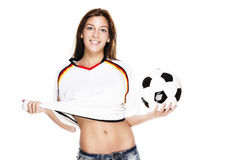 Confident young woman holding football pulling her Royalty Free Stock Images