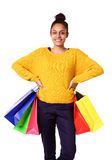 Confident young woman holding shopping bags Royalty Free Stock Images