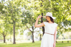 Confident young woman holding sun hat Royalty Free Stock Photo
