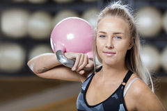 Confident Young Woman Lifting Kettlebell In Gym Stock Photos