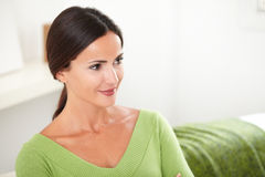 Confident young woman looking away at indoors Stock Images