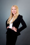 Confident young woman in suit Stock Image