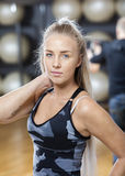 Confident Young Woman Touching Neck In Gym Royalty Free Stock Photos