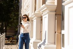 Confident young woman walking stock photography