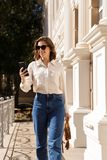 Confident young woman walking royalty free stock image