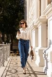 Confident young woman walking royalty free stock photography