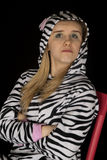 Confident young woman wearing cat pajamas with her arms folded Stock Photo