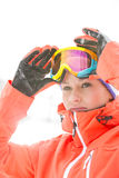 Confident young woman wearing ski goggles outdoors Royalty Free Stock Photos
