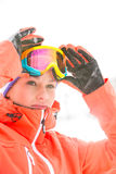 Confident young woman wearing ski goggles outdoors Royalty Free Stock Image