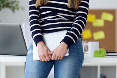Confident young woman working in her office with digital tablet. Stock Images