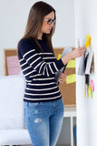 Confident young woman working in her office. Portrait of confident young woman working in her office Royalty Free Stock Photo