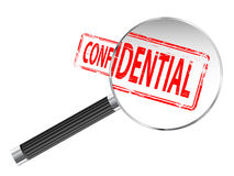 Confidential. Rubber stamp under a magnifying glass Stock Photos