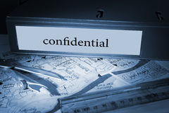 Confidential on blue business binder Stock Images