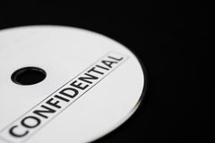 Confidential cd on black Stock Photography