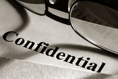 Confidential Document in File Folder and Glasses  Royalty Free Stock Photo