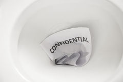 Confidential document flush away Royalty Free Stock Photo