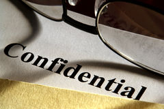 Confidential Document in Folder with Glasses Royalty Free Stock Images