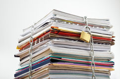 Confidential documents. File stack locked with chain and padlock Stock Images