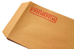 Confidential envelope A. Manila envelope with confidential stamped on it Stock Photos