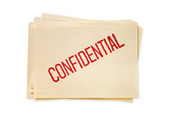 Confidential Files. Stack of manilla file folders, stamped confidential Royalty Free Stock Images