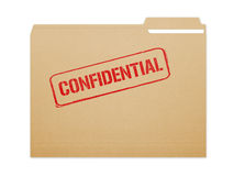 Confidential Folder. Confidential brown folder file with paper showing with a lot of copy space. Isolated on a white background with clipping path Stock Images
