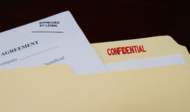 Confidential Legal Document. A business contract with an Approved By Legal stamp in a confidential file stock photography