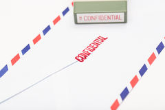 The Confidential Letter, stamping confidential. Break through the Confidential Letter Royalty Free Stock Photography