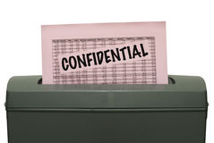Confidential paper into shredder Royalty Free Stock Images