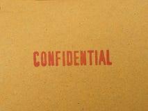Confidential printed on brown vintage envelope, in macro. Confidential printed on brown vintage envelope Stock Photo