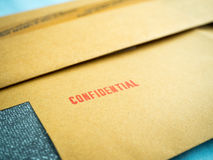 Confidential printed on brown vintage envelope, in macro Royalty Free Stock Photography