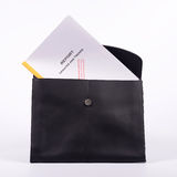 Confidential report. In black brieftcase on white background Royalty Free Stock Images