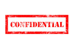Confidential rubber stamp. In red ink Royalty Free Stock Photos