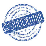 Confidential stamp. Blue grunge office rubber stamp with the word confidential Royalty Free Stock Images