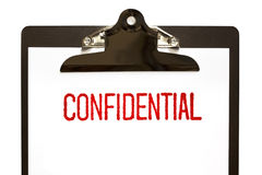 Confidential Stamp on Clipboard Royalty Free Stock Image