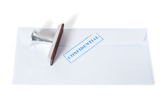 Confidential stamp on envelope. Isolated on white background Stock Photo