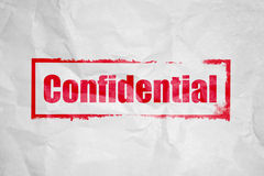Confidential stamping. On white corrugate paper Royalty Free Stock Photos
