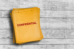 Confidential stmp on yellow envelope Stock Images