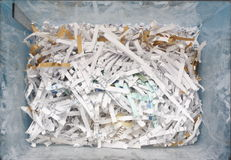 Confidential Waste. A blue plastic container of confidential waste paper shredded and ready for recycling, photographed from above Stock Image