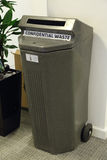 Confidential Waste Container. A confidential waste container in an office Stock Image